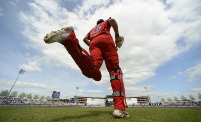 England\'s captain Alastair Cook runs out to bat during the second one-day international cricket...