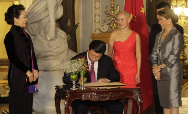 China\'s President Xi Jinping signs a guest book in honour of the National Theatre...