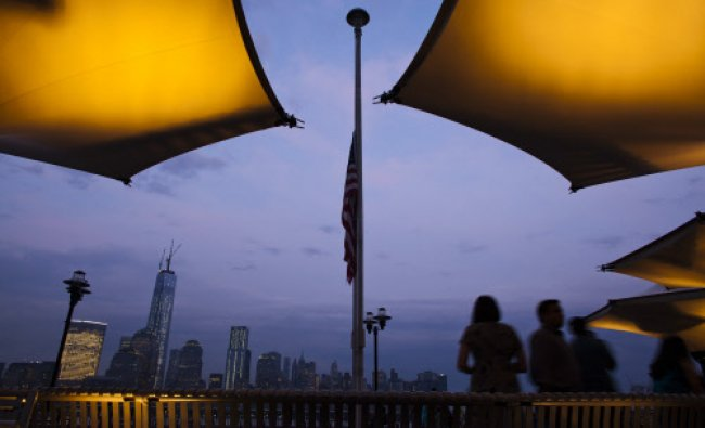 A U.S. flag is seen at half-staff in honor of U.S. Senator Frank Lautenberg in Exchange Place...