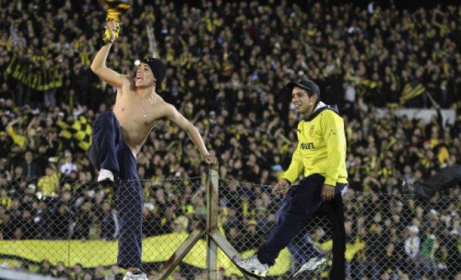 Fans of Penarol celebrate after winning the Uruguay Championship after defeating Defensor...