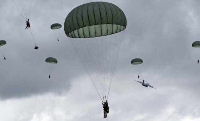 In this photo provided by the U.S. Army, the 4th Brigade Combat Team (Airborne), 25th Infantry...