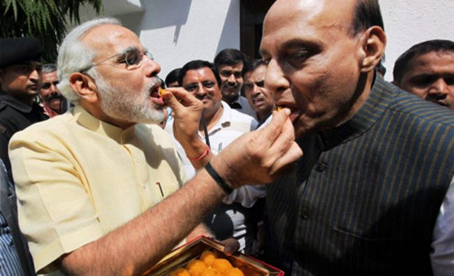 Gujarat CM Narendra Modi and BJP President Rajnath Singh offering sweets to each other