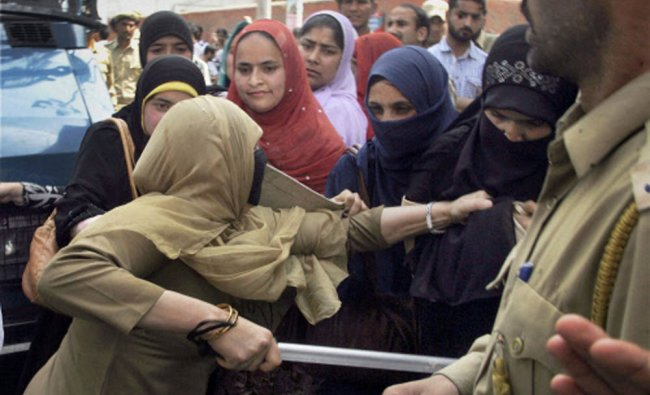 Female employees of National Youth Corps scuffle with the police during their hunger strike