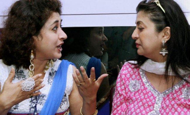 Tollywood actress and TMC, MP, Satabdi Roy (L) and MLA,Debasree roy share a light word