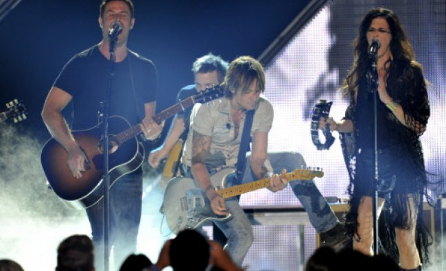 Jimi Westbrook, left, and Karen Fairchild, right, of Little Big Town, and Keith Urban, center...