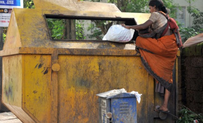 Pangs of Hunger... A baby feeds on its mother, while the mother searches for rags in a garbage...