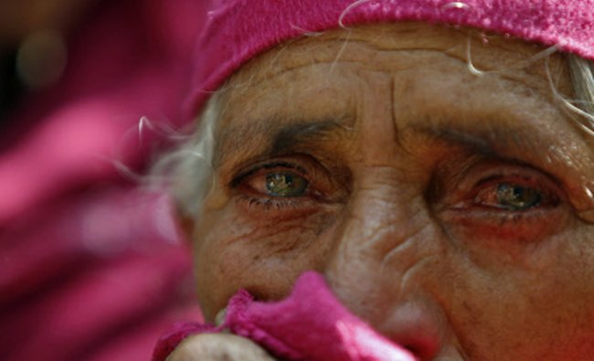 A woman mourns during the funeral of Mohammed Abbas Nangroo, a militant commander at...