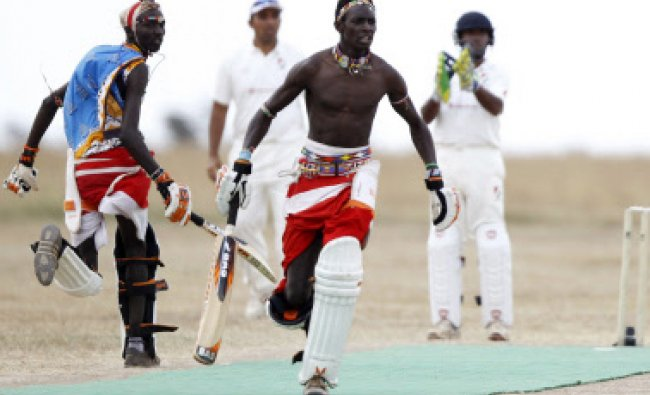 Sonyanga Olengais (C), captain of the Maasai Cricket Warriors, and his teammate Thomas Takare run...