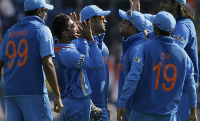 India\'s Ravindra Jadeja, second left, celebrates with teammates after taking a catch to dismiss...
