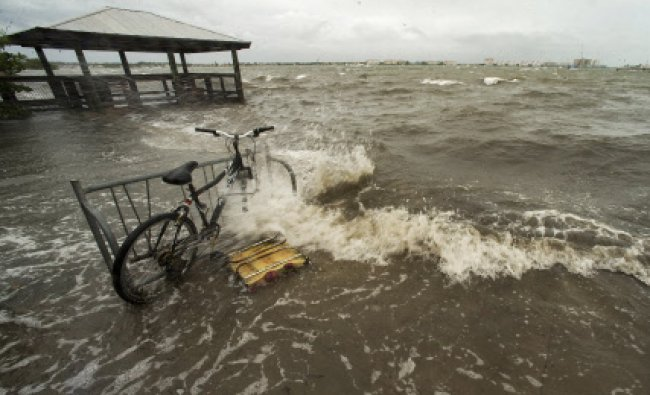 Water from Boca Ciega Bay washes ashore as wind and rain from Tropical Storm Andrea hit the...