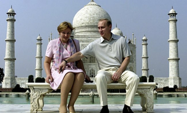 Russian President Vladimir Putin and his wife Lyudmila sit in front of the Taj Mahal while...