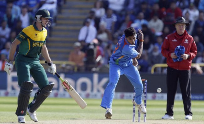 Umesh Yadav, right, puts down a half chance of a catch of South Africa\'s Francois du Plessis...