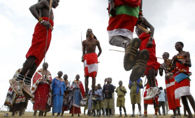 Members of the Maasai Cricket Warriors sing and jump to their traditional rhythm after their...