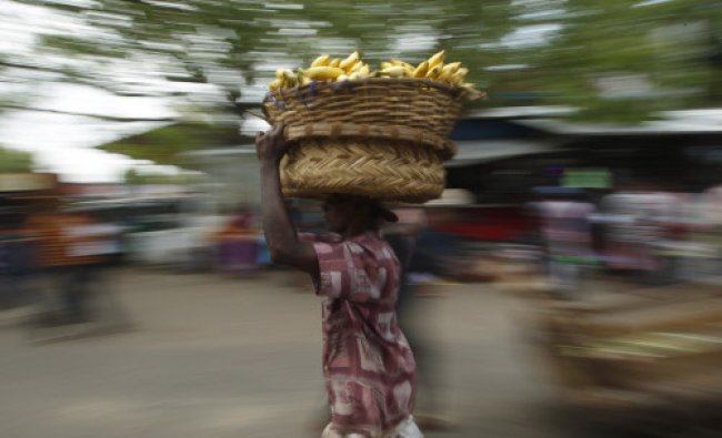 A worker carries a basket of bananas at a market in Colombo June 7, 2013. Sri Lanka\'s central...