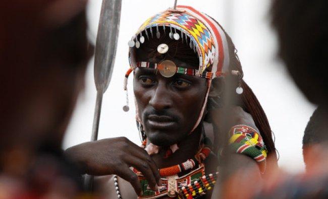 Jonathan Ole Meshami of the Maasai Cricket Warriors prepares to sing and jump...