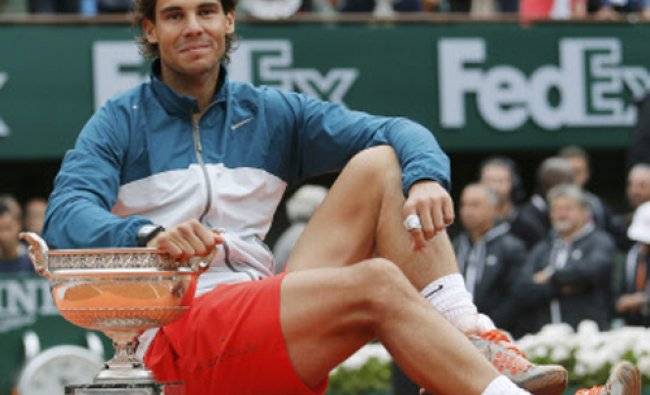 Rafael Nadal of Spain poses with the trophy after defeating compatriot David Ferrer in their...