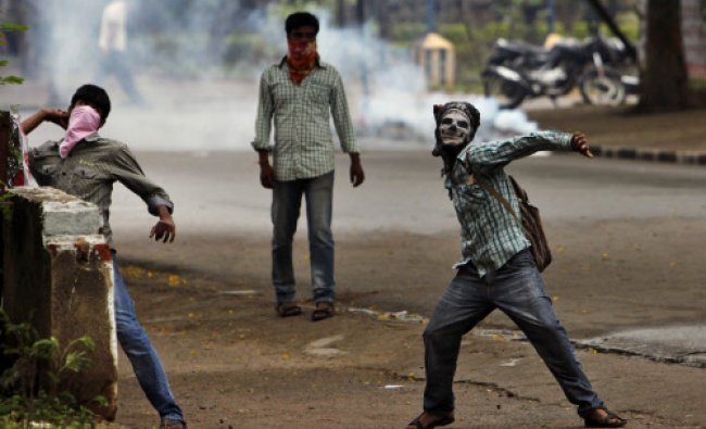 Student protestors hurl stones at policemen during a protest demanding creation of a new state...