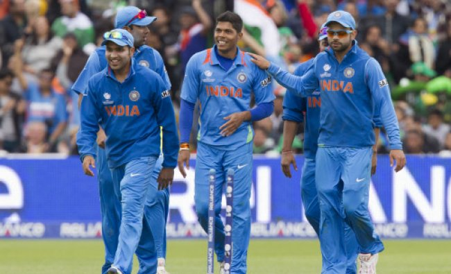 Umesh Yadav, centre, celebrates with teammates after running out Pakistan\'s Muhammad Irfan...