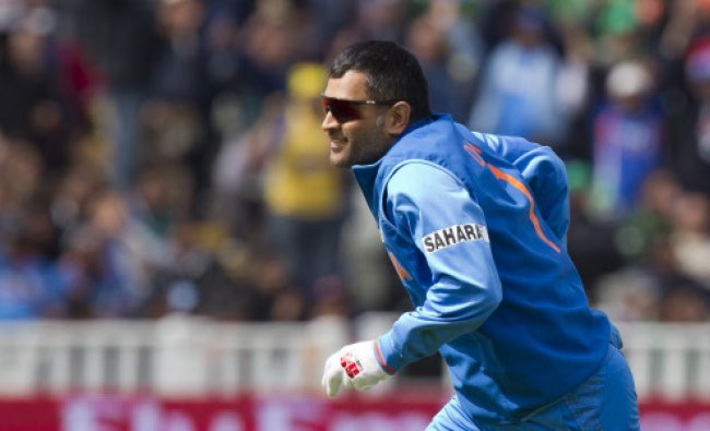 MS Dhoni reacts after catching Pakistan\'s Asad Shafiq for 41 off the bowling of Ishant Sharma...
