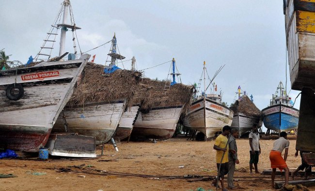 Fishing boats parked on coasts ahead of anticipated heavy rain in Mangalore on Sunday.