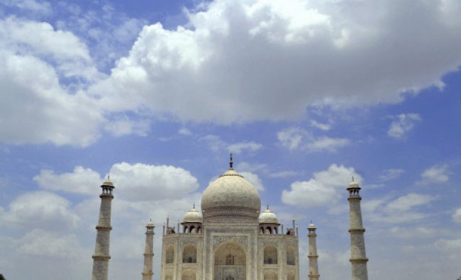 Clouds hover in the sky over the historic Taj Mahal in Agra on Saturday. PTI Photo