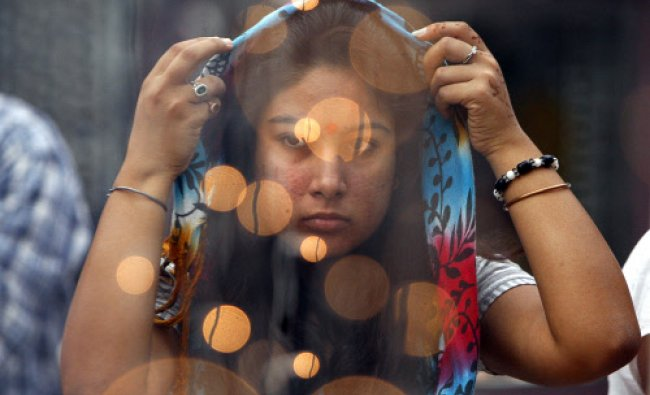 A woman prays at the Kheer Bhawani temple during an annual Hindu festival in Jammu, India, Monday...