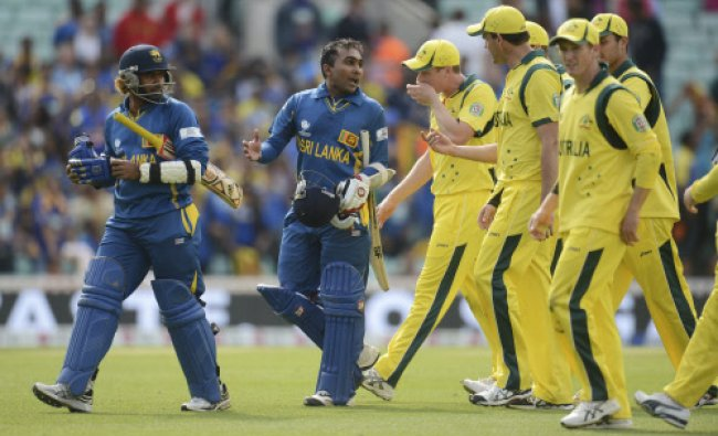 Sri Lanka\'s Mahela Jayawardena (2nd L) speaks to Australia\'s Clint McKay as the players leave...