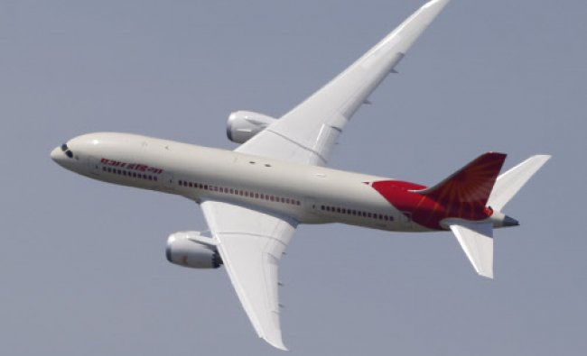 An Air India Boeing 787 Dreamliner performs its demonstration flight during the first day...