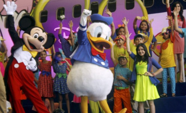 Winner kids from across India walk celebrate special Disney collection in Mumbai on Monday. PTI