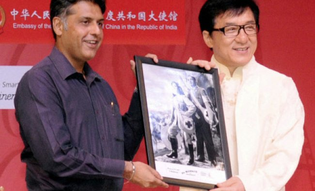 Union I & B Minister Manish Tewari (L) presents a memento to Chinese Actor, Director Jackie Chan...