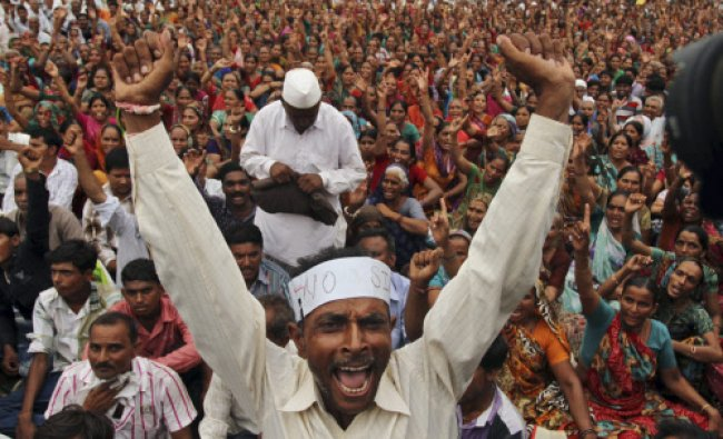 A farmer shouts slogans during a protest rally in Gandhinagar, 30 kilometers (19 miles) north...