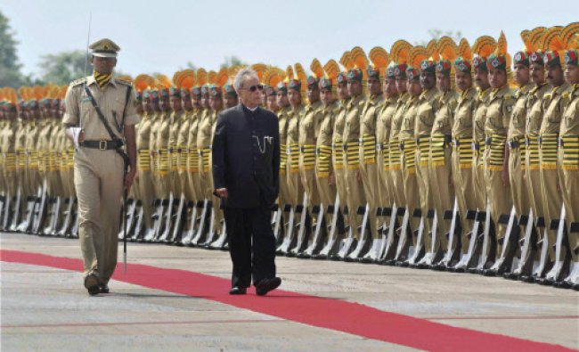 President Pranab Mukherjee inspecting a guard of honour at the airport in Agartala on Thursday.