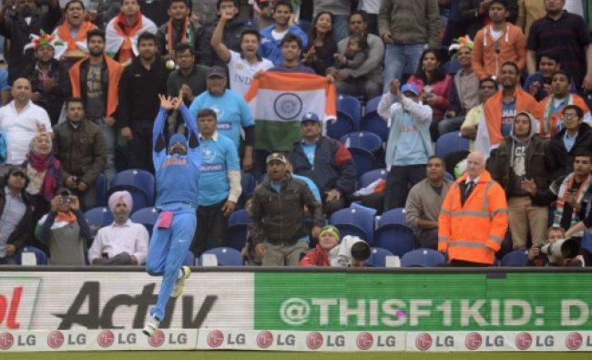 Spectators watch as India\'s Virat Kohli fails to catch a ball hit by Sri Lanka\'s Angelo Matthews...