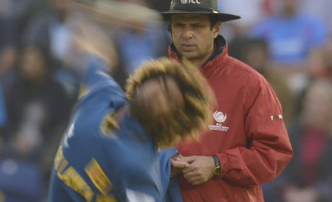 Sri Lanka\'s Lasith Malinga bowls a delivery as umpire Aleem Dar looks on during the ICC Champions...