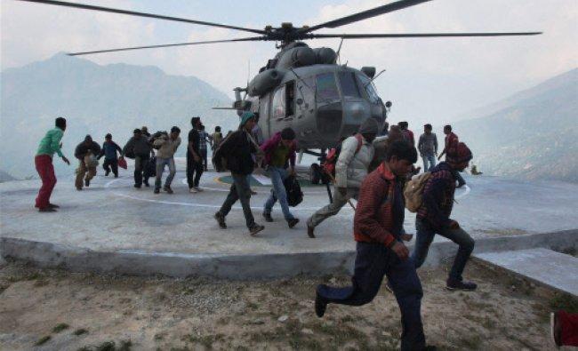 Rescued pilgrims from Gauri Kund alighting a chopper at Guptkashi in Uttarakhand on Friday. PTI