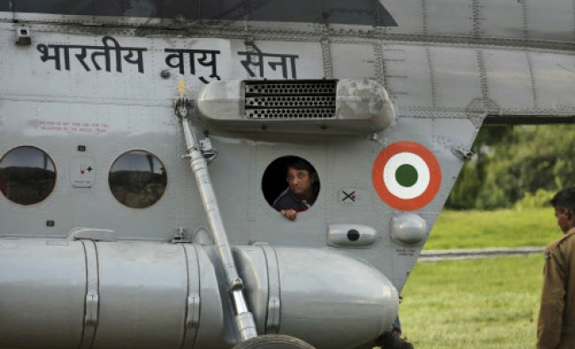 A man watches from inside an Indian Air Force helicopter after being evacuated by army personnel...