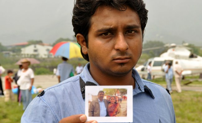 Neelesh shows a photograph of his parents, who went missing in Uttarakhand ...