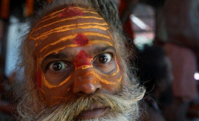 An Indian Sadhu or Hindu holy man reacts to the camera during Ambubasi festival at Kamakhya...