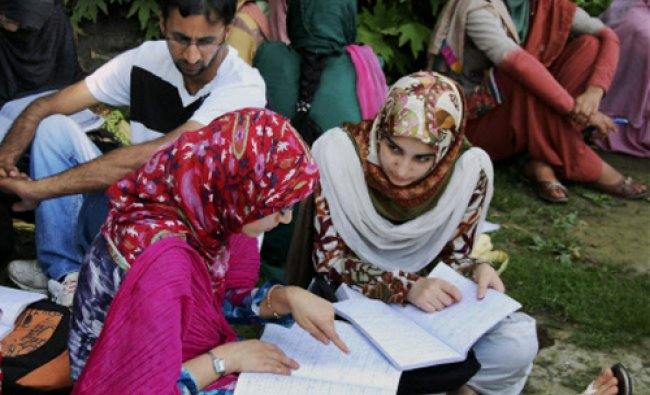 Girl candidates preparing for Board of Professional Entrance Examination (BOPEE) studying outside...