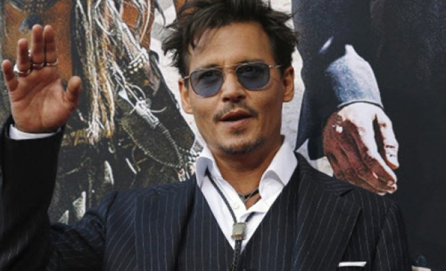 Cast member Johnny Depp waves at the world premiere of \'The Lone Ranger\' at Disney California...