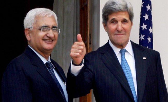 External Affairs Minister Salman Khurshid with U.S. Secretary of State John Kerry before a meeting..