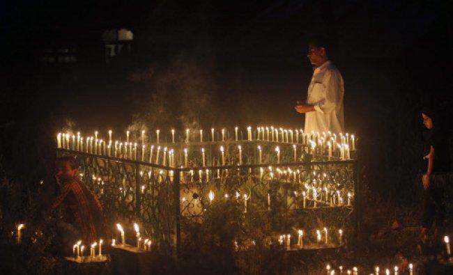 Kashmiri Muslims illuminate the graves of their relatives and offer prayers on Shab-e- Barat...