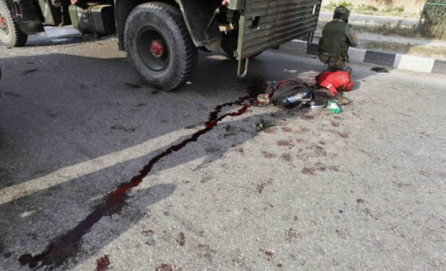 A soldier takes position at the scene of an encounter with separatist militants in Srinagar...