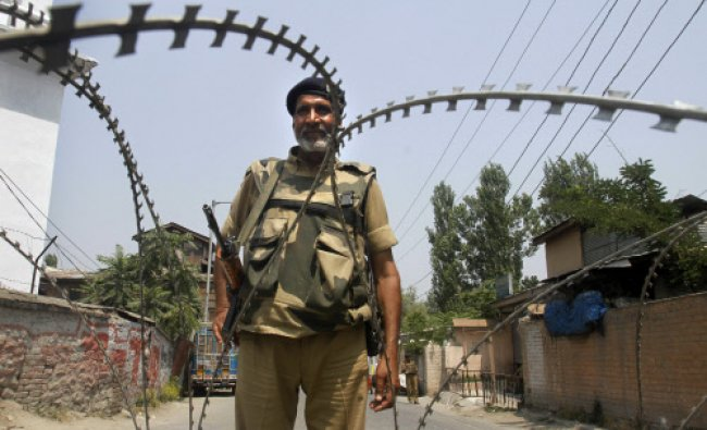 A paramilitary force soldier stands guard during a strike in Srinagar, India...