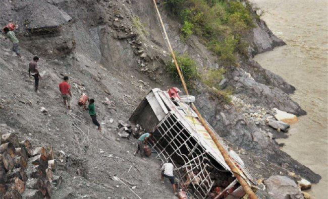 A truck carrying LPG cylinders falls in Bhagirathi River from a washed away road in Uttarkashi...