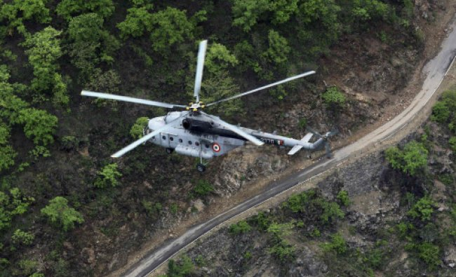 An Indian Air Force (IAF) helicopter, part of a rescue operation, flies over the Gauchar area...