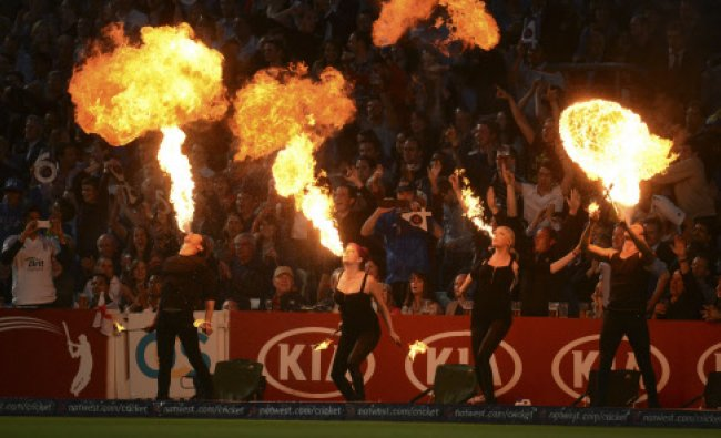 Performers near the boundary breathe fire after a four was hit during the first T20 international...