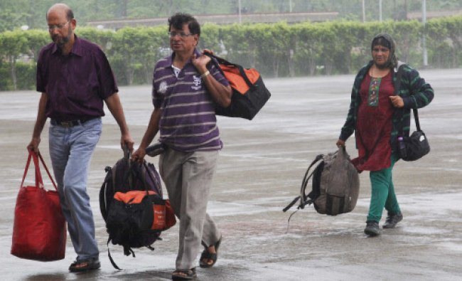 Pilgrims at Jollygrant Airport in Dehradun on Thursday after they were rescued by the army...