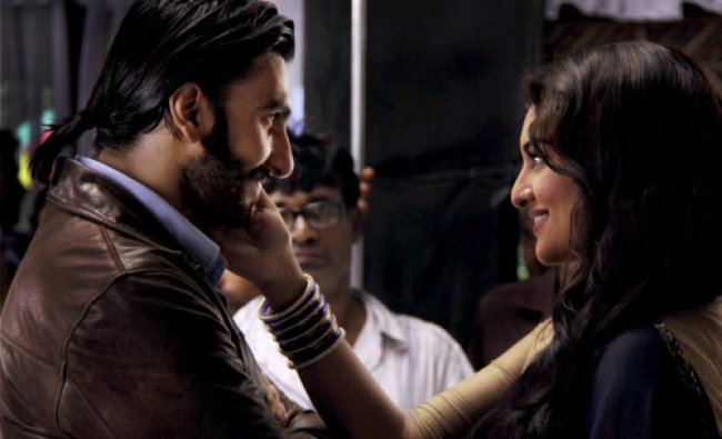 Ranveer Singh and Sonakshi Sinha posing during promotion of their upcoming movie \'Lootera\' in Mumbai