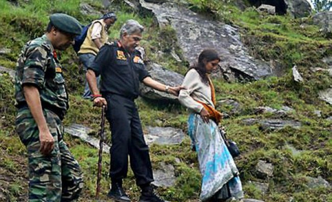 General Officer Commanding in Chief of Central Command, Lt. Gen. Anil Chait accompanies stranded...